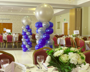"Grand balloon columns with 24"" topper"